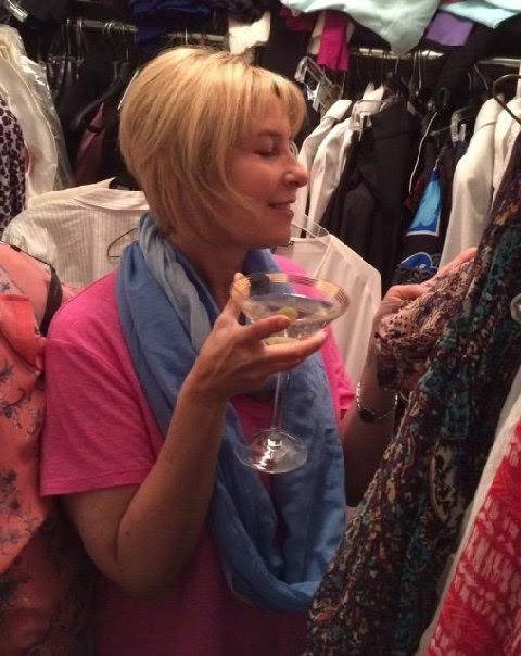 Cleaning closet with a martini in hand